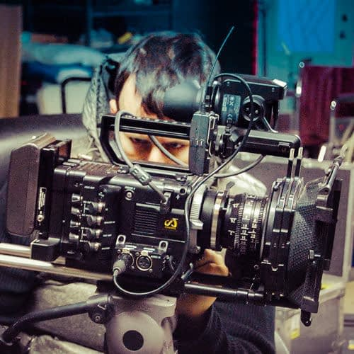 The DOP setting op the camera before the shoot of a short film